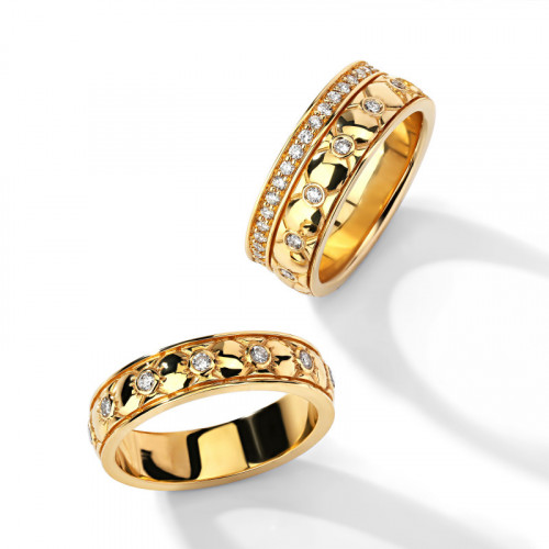 Дизайнерские свадебные кольца из желтого золота