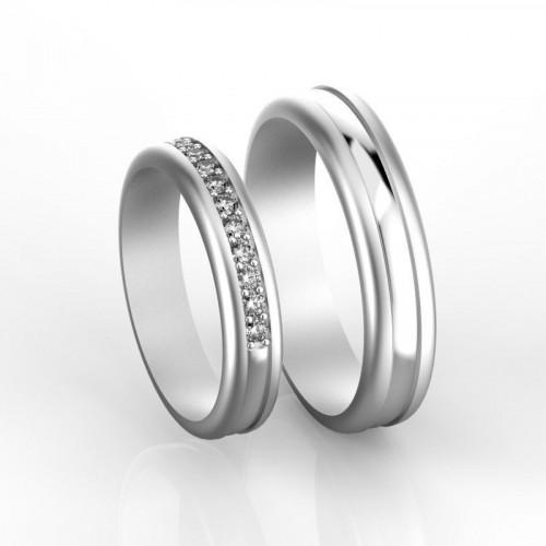 Свадебные кольца из белого золота с дорожкой бриллиантов 686991