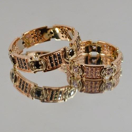Авторские многокаменные обручальные кольца из комбинированного золота AU950224