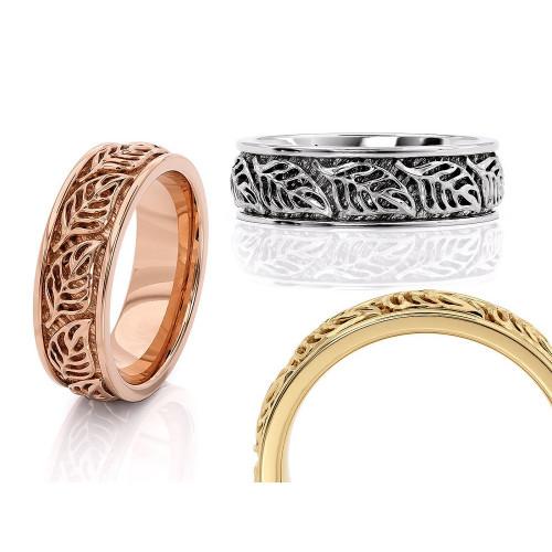 Золотые свадебные кольца с изображением листьев