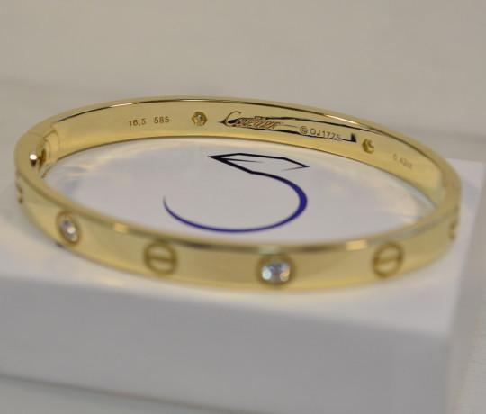 Женский золотой браслет в стиле Cartier