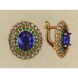 Женские золотые серьги из комбинированного золота с синими овальными камнями 0193